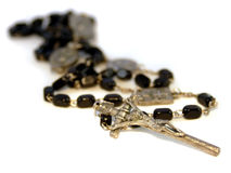 Catholic Rosary. A Catholic Rosary with short depth of field from the crucifix to the beads Stock Images