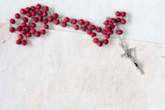 Catholic rosary on old paper sheets. Royalty Free Stock Photo