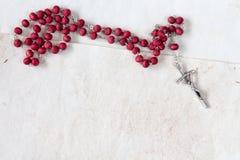 Catholic rosary on old paper sheets. Catholic rosary on old paper sheets with copy-space Royalty Free Stock Photo