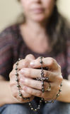 Catholic Woman Praying. With a Rosary Royalty Free Stock Photo