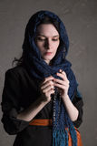 Catholic woman praying with a rosary Royalty Free Stock Photos