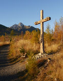 Catholic wooden cross in autumn landscape Stock Photo