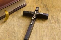 Catholic wooden crucifix and book Royalty Free Stock Photo