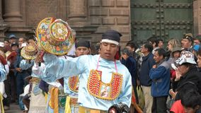 Catholic worshipers dancing at the cathedral of cusco in peru