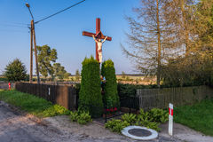 Catholicism in Poland. Wayside cross in small village of Pomorskie Region in Poland stock photos