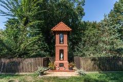 Catholicism in Poland. Wayside shrine in Rzepiczna village in Kujawy-Pomerania Province of Poland royalty free stock photography