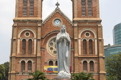 Christians in Asia. Vietnam is asian country with highest number of Christians. Here we can see sculpture of Mother Mary in front of cathedral in District 1 in Royalty Free Stock Photography