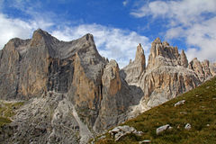 Catinaccio peak and Vajolet Towers. The dolomitic walls of Vajolet Towers and Catinaccio peak stand out against summer sky Royalty Free Stock Photo