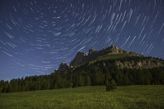 Catinaccio and star trails at the moonlight, Karerpass - Dolomit Stock Photos