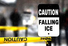 Cation! Falling Ice. Falling Ice sign on the sidewalk during winter time royalty free stock images