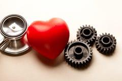 Catracas, estetoscópio e coração Fotografia de Stock
