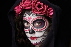 Catrina skull look. Close up of catrina skull look with cloak isolated on black stock photos