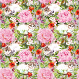 Cats lying in grass, flowers. Floral seamless pattern. Watercolor Royalty Free Stock Photo