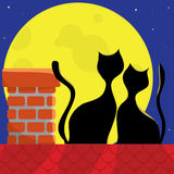 Cats on the roof. Love the cats on the roof of a full moon Stock Photo