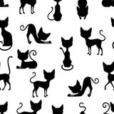 Cats Seamless Pattern. Seamless background pattern with silhouettes of black cat sitting in different poses vector illustration Royalty Free Stock Photo