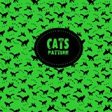 Cats seamless pattern. Stylish black cats pattern on a green background. Vector illustration Stock Photography