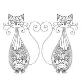 Cats with tails in hart shape Stock Photo