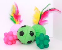 Cats Toys. Of balls with feathers, soccer ball and magic jumping all around balls Stock Image