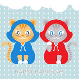 Cats wearing raincoat in rainy day. Vector illustration of cats wearing raincoat in rainy day Stock Photos
