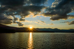 Catskills Sunburst. New York is more than just a city. Just 100 miles north of the big city lie the Catskills Mountains and this sunset features them and the Royalty Free Stock Photography