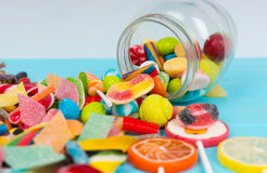 Cattered Tasty Candies And Lollipops As Fruits Near Fallen Glass