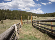 Cattle corral. Timber post and rail corral or cattle yard on a hillside in an American wilderness area Stock Photos
