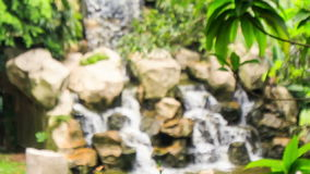 Cattle Egret Sits against Waterfall Flies away stock footage