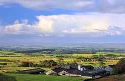 Bowland cattle farm, Lancashire. The large agricultural sheds of a Lancashire cattle farm, nestled just below the hills of the Forest of Bowland. The fields and Royalty Free Stock Images