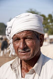 Cattle farmer with scarf around his head. Royalty Free Stock Image