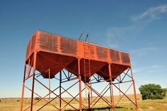 Cattle feed tower. Low angle view of colorful cattle or livestock feeding structure with blue sky background Stock Photography