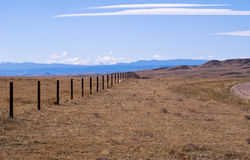 Cattle fence on the high plains. Rocky Mountains in the background of a high plains drift fence Stock Images