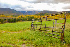 Cattle Gate by Field in Mountains Stock Photo