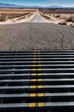 Cattle grate crossing in a road to mountains Stock Images