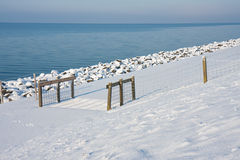 Cattle grid along the snowy coast  the Netherlands Stock Photos