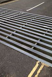 Cattle grid on road Royalty Free Stock Photography