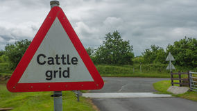 Cattle Grid Sign next to Cattle Grid. Warning cars to slow down Stock Photography