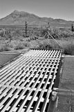 Cattle guard in the desert. Black and white monochrome of a cattle guard in the Arizona desert. A stark but scenic view of rural life stock image