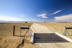 Cattle guard at the intersection between the C37 and D31 roads between the towns Noordoewer, Ai-Ais Fish River Canyon. And Aussenkehr. Gravel roads, mountains Royalty Free Stock Photos