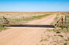 Cattle guard to eliminate a gate in the fence royalty free stock images