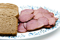 Cattle ham with toast bread on plate. And on white background Royalty Free Stock Photo