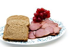 Cattle ham with toast bread. On plate and on white background Stock Photos