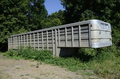 Cattle mover parked in the weeds Royalty Free Stock Image