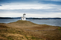 Cattle Point Lighthouse. Poised on a steep wind swept bluff, the Cattle Point Lighthouse marks the southernmost tip of San Juan Island in the Puget Sound area of Stock Photography
