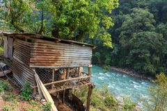 Cattle shelter over a mountain river. Royalty Free Stock Photos