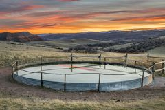 Cattle water tank at Colorado ranch. Cattle water tank in Colorado mountain ranch - Red Mountain Open Space near Fort Collins, sunset scenery Stock Photo