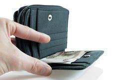 Cattura dei soldi dal raccoglitore Fotografie Stock Libere da Diritti