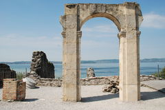 Catullo's Cave ruins. A view of lake of Garde through a riun arch in Catullo'sCave Royalty Free Stock Image