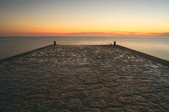 Holiday picture,Wharf viewing,Pier viewing,sea,sunset viewing. Pedestrian walkway that juts out into the sea. sunset time.holiday Image Stock Images