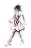 Catwalk Figure. Fashion illustration showing a woman wearing an eccentric outfit in black,white and red. Created with ink and coloured pencils Royalty Free Stock Image