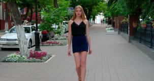 Defile Young Woman Walking Toward The Camera And Stock ...